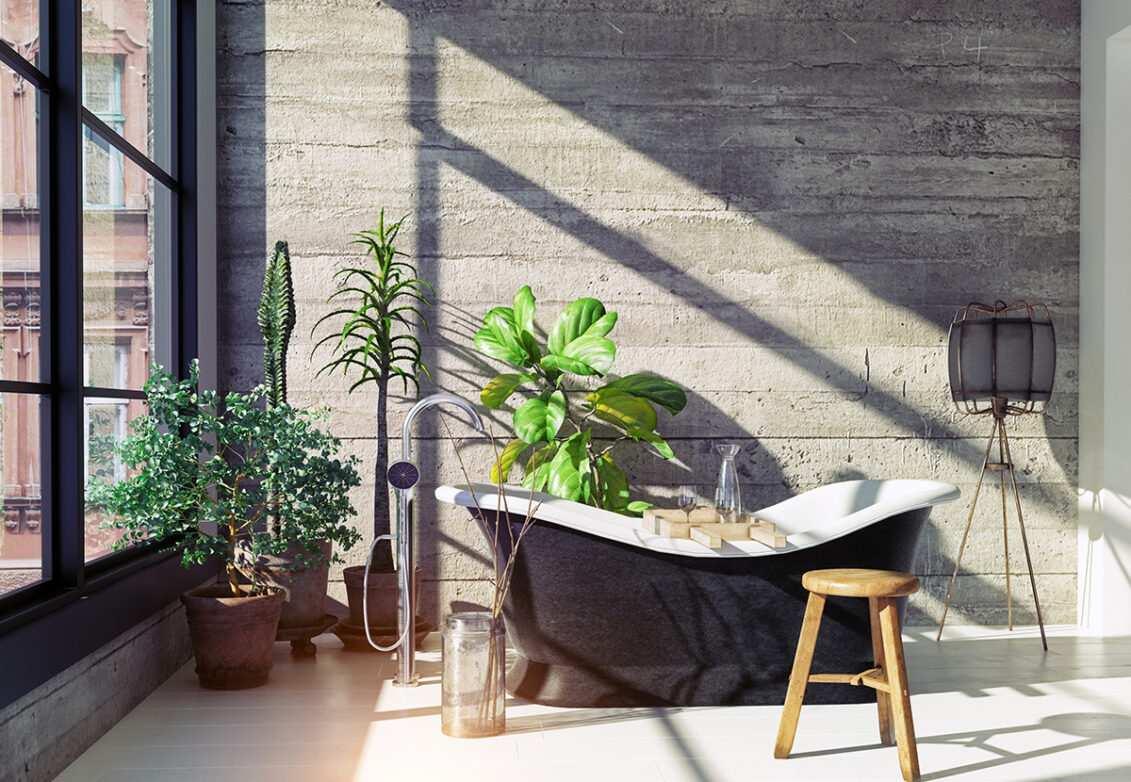 Une salle de bain avec un mur en béton